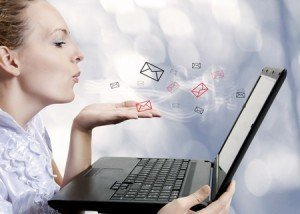 Concept-young-attractive-woman-with-laptop-computer-sending-emails-on-forum-chat-or-blog.-Blogger-300x214